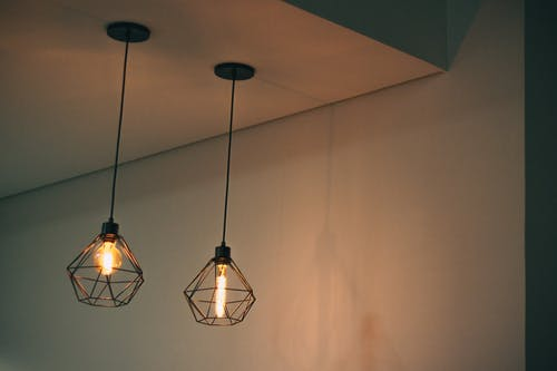 Two Black Pendant Lamp on White Concrete Ceiling