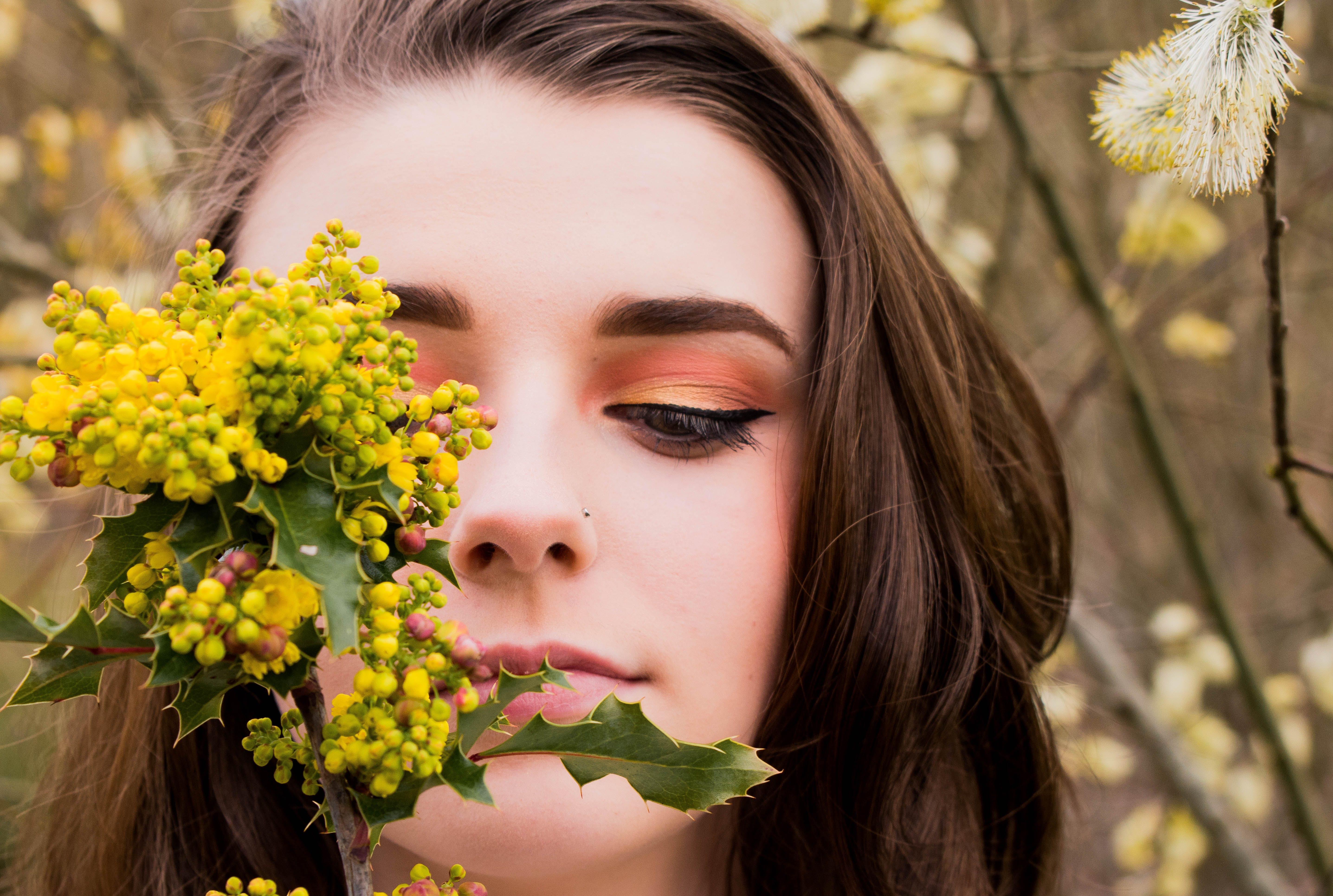 Woman Looking at a Green and Yellow Leafed Plant