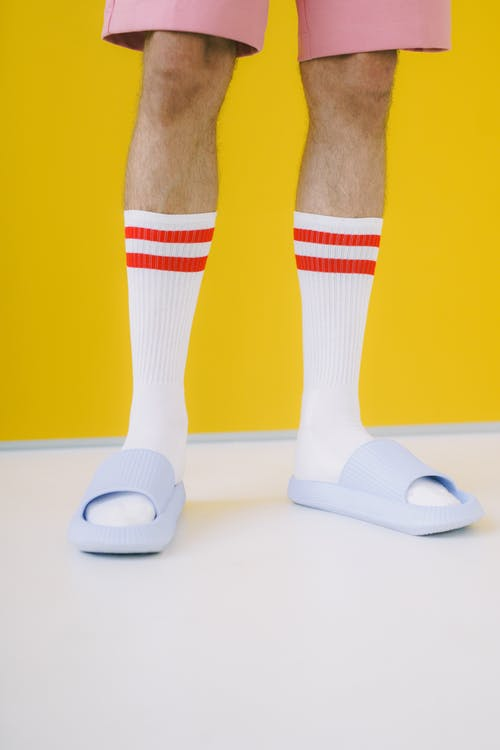 Close up view of man in white socks and flip flops