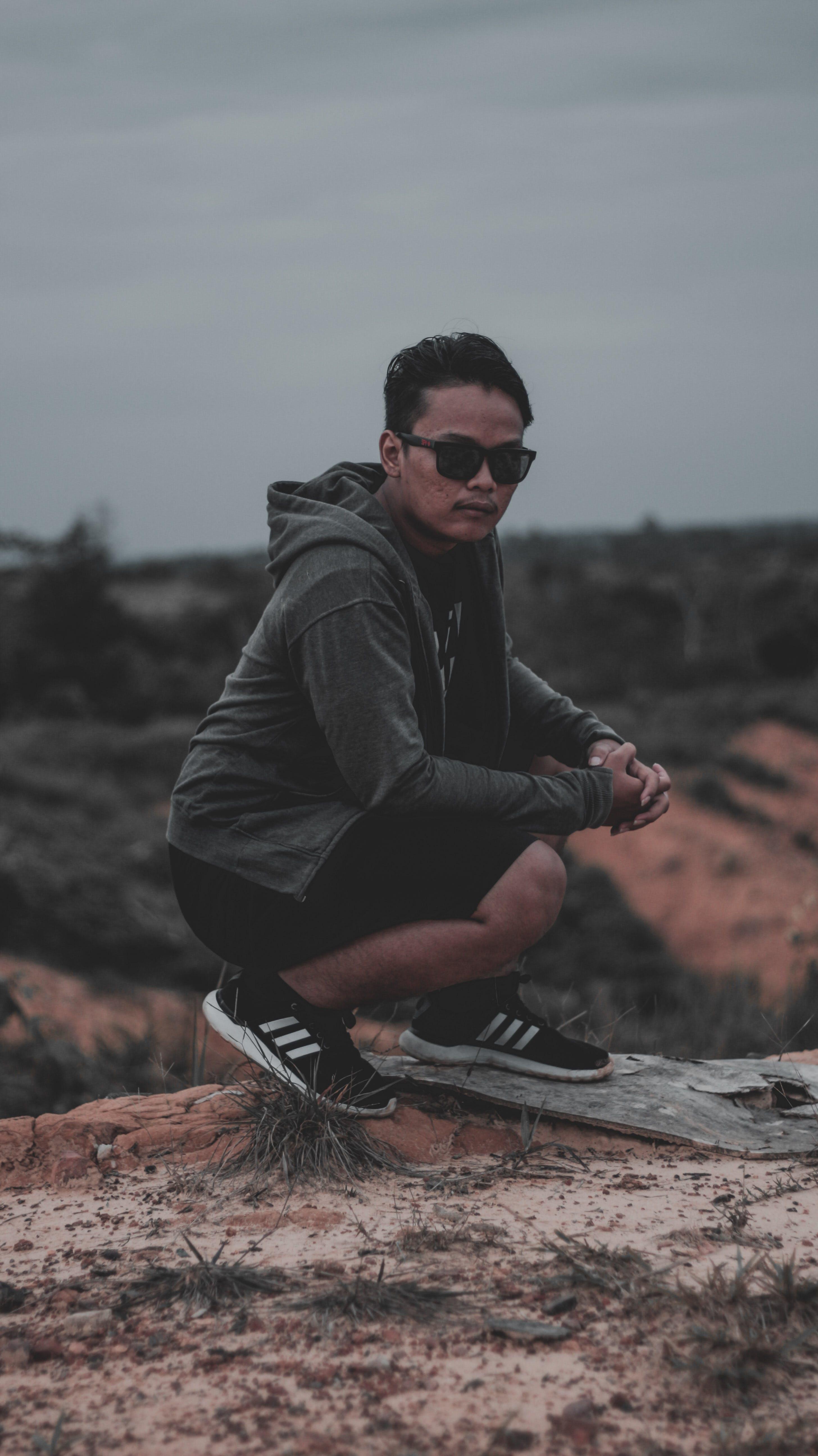 Man Wearing Hoodie Near Cliff