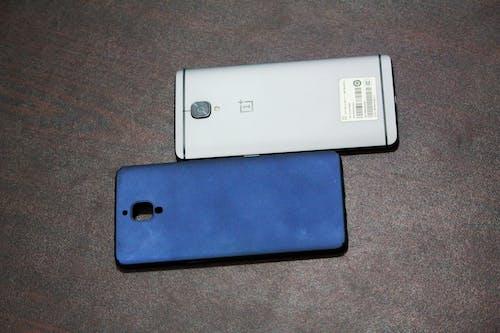 Free stock photo of cell phone, gunmetal, navyblue