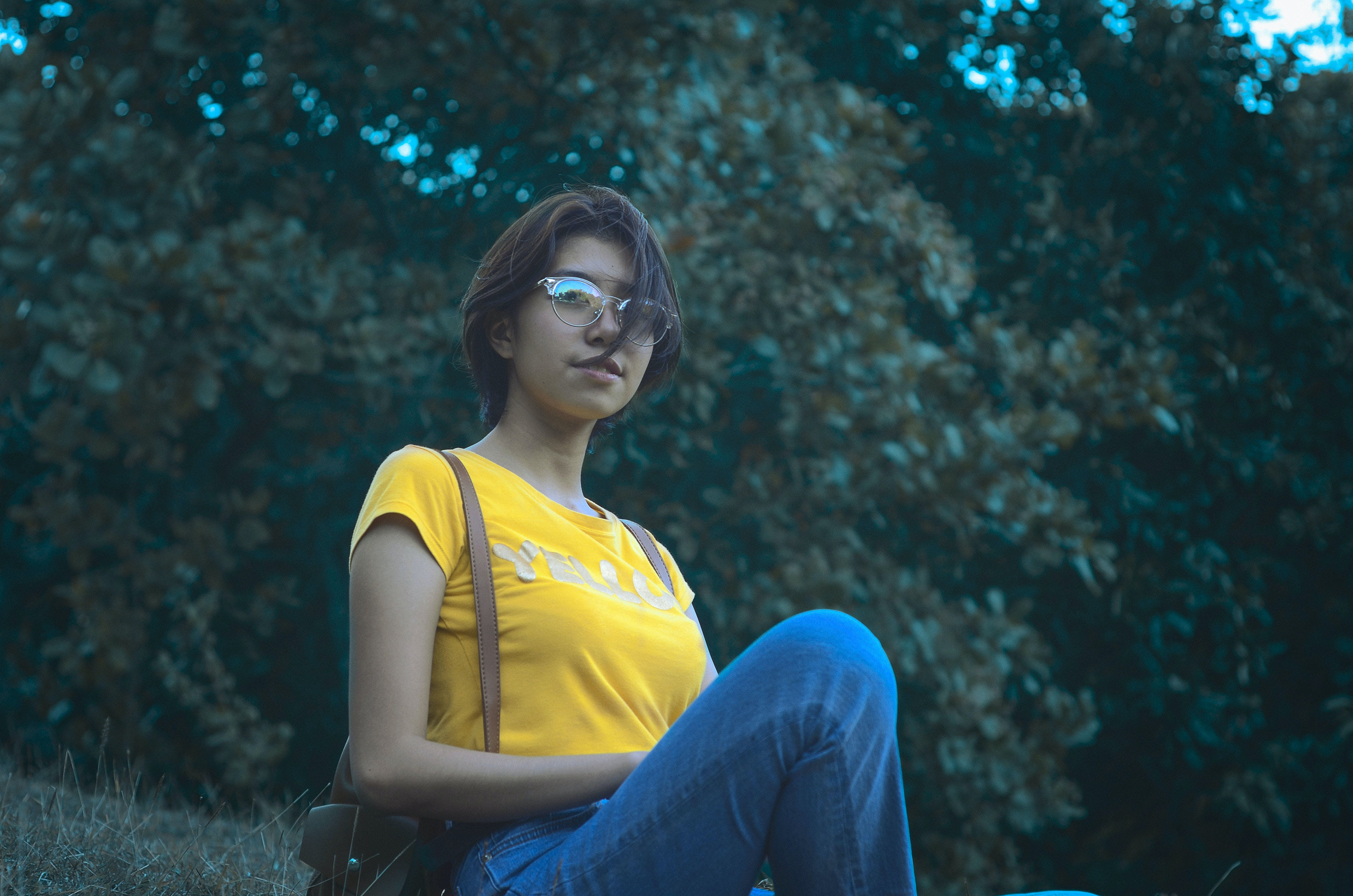 Woman in Yellow Short-sleeved Top and Blue Denim Jeans