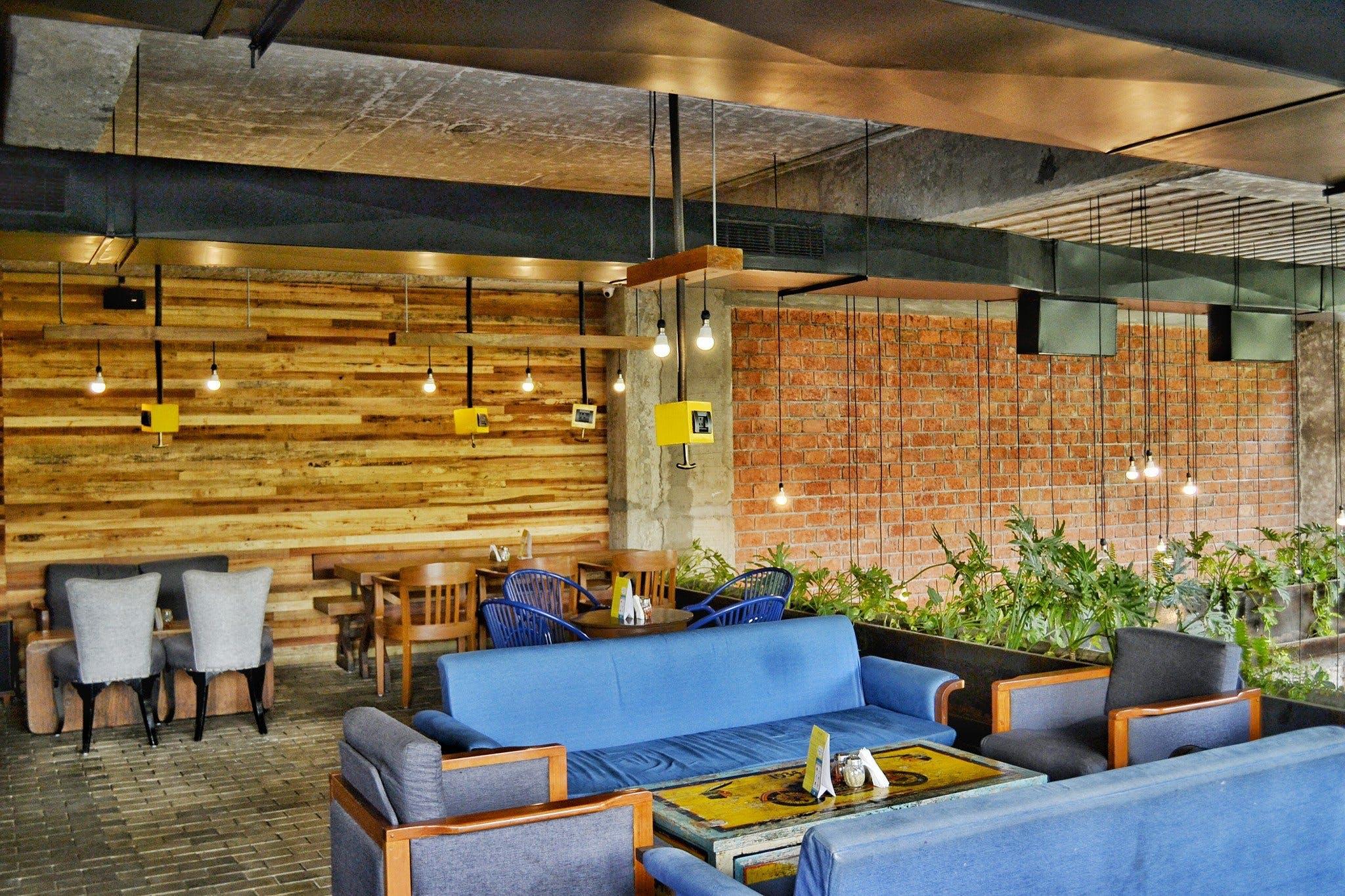 Blue Fabric 4-piece Sofa Set Under Lighted Hanging Bulbs
