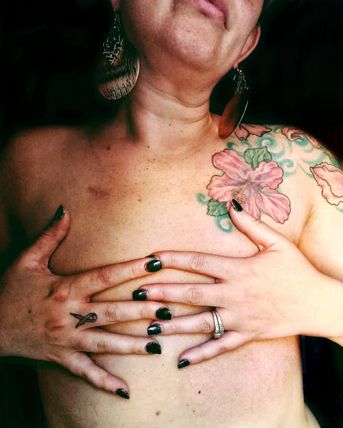 Topless Woman With Silver Ring and Silver Ring