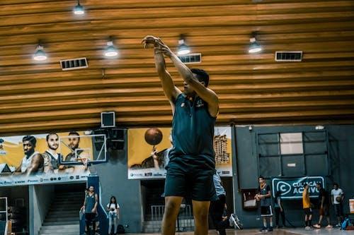 Foto stok gratis atlet, bola, cahaya, kerumunan orang