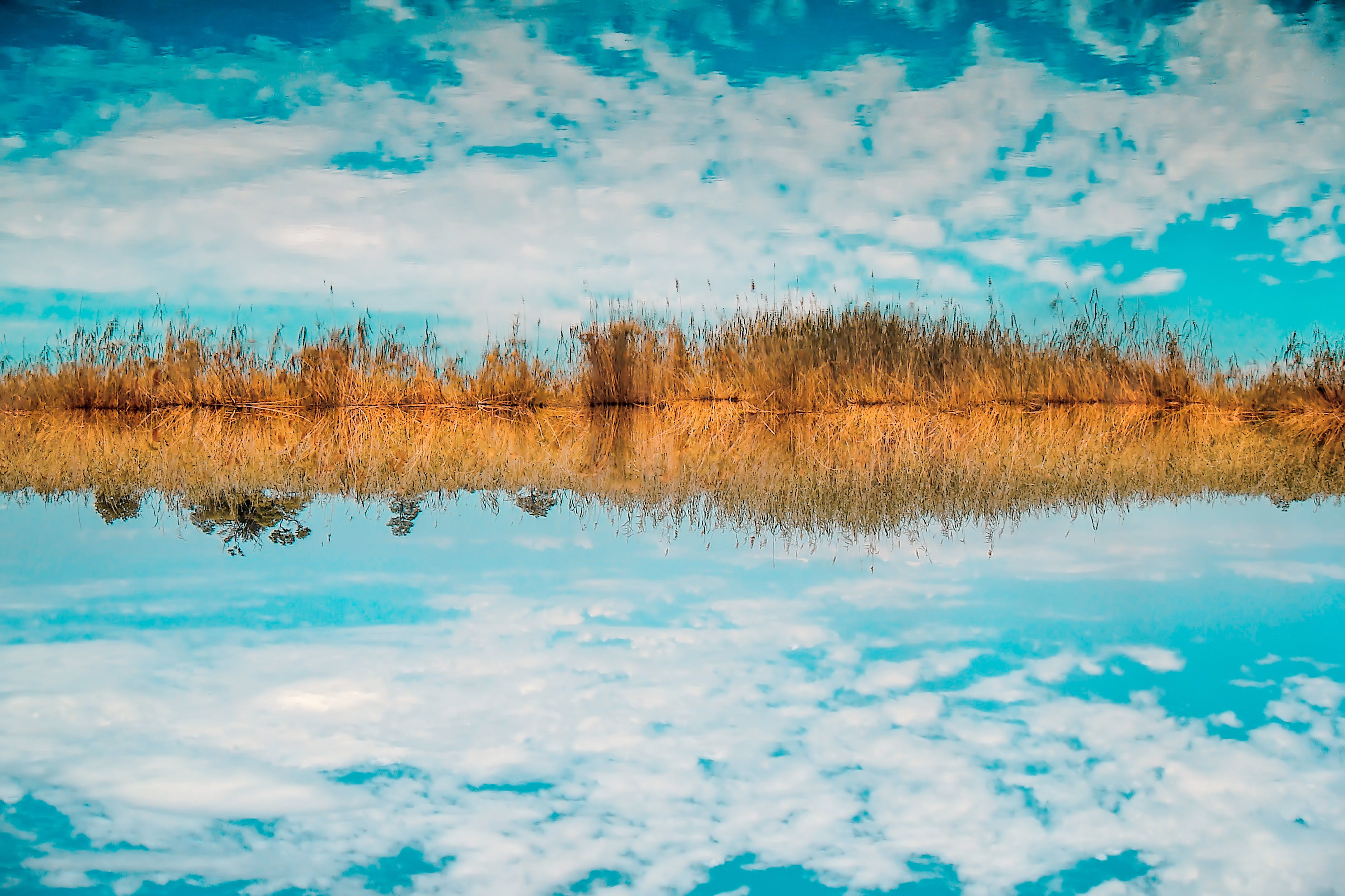 Landscape Photography of Sky Reflect to Body of Water