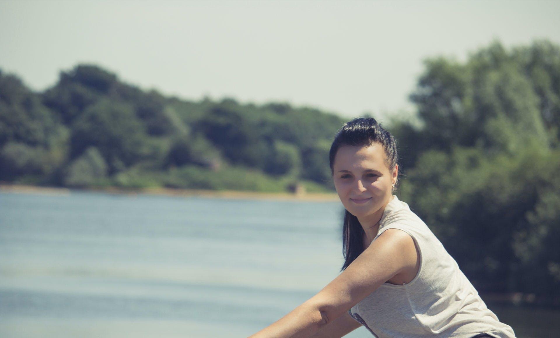 Smiling Woman Wearing White Sleeveless Shirt