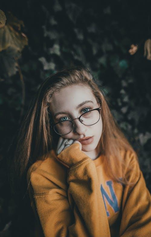 Woman in Brown Jacket Wearing Black Framed Eyeglasses