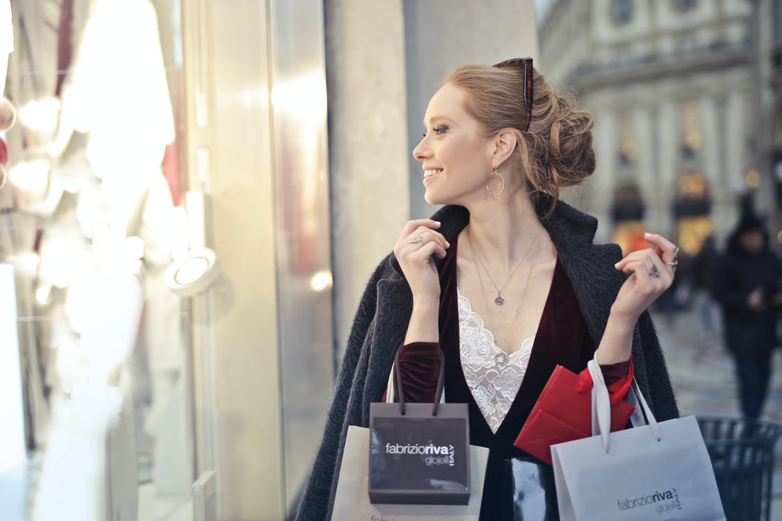 Woman Wearing Black Blazer Holding Shopping Bags