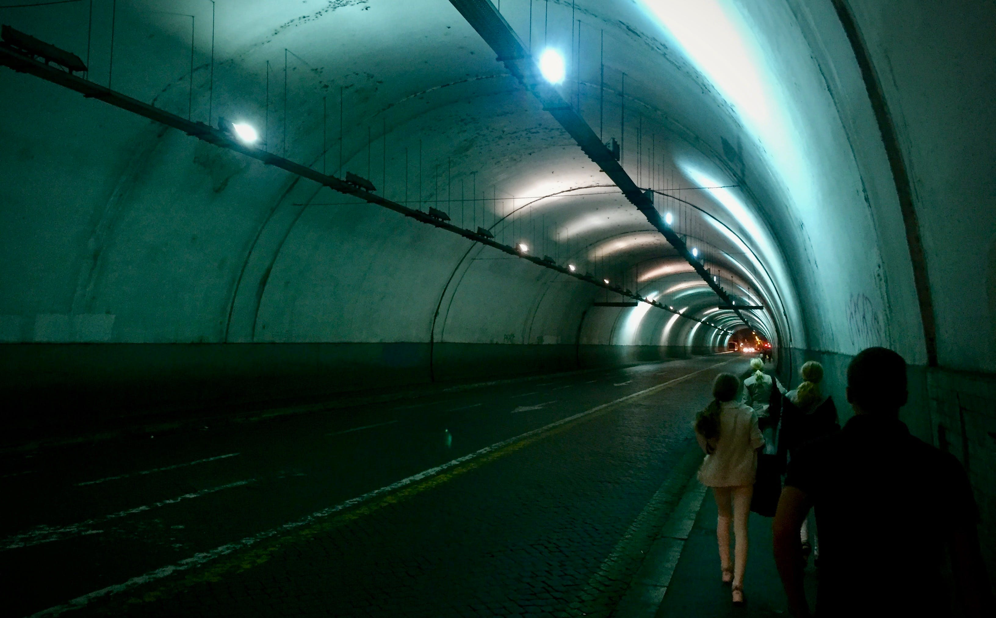 Group of Persons Passing by Tunnel