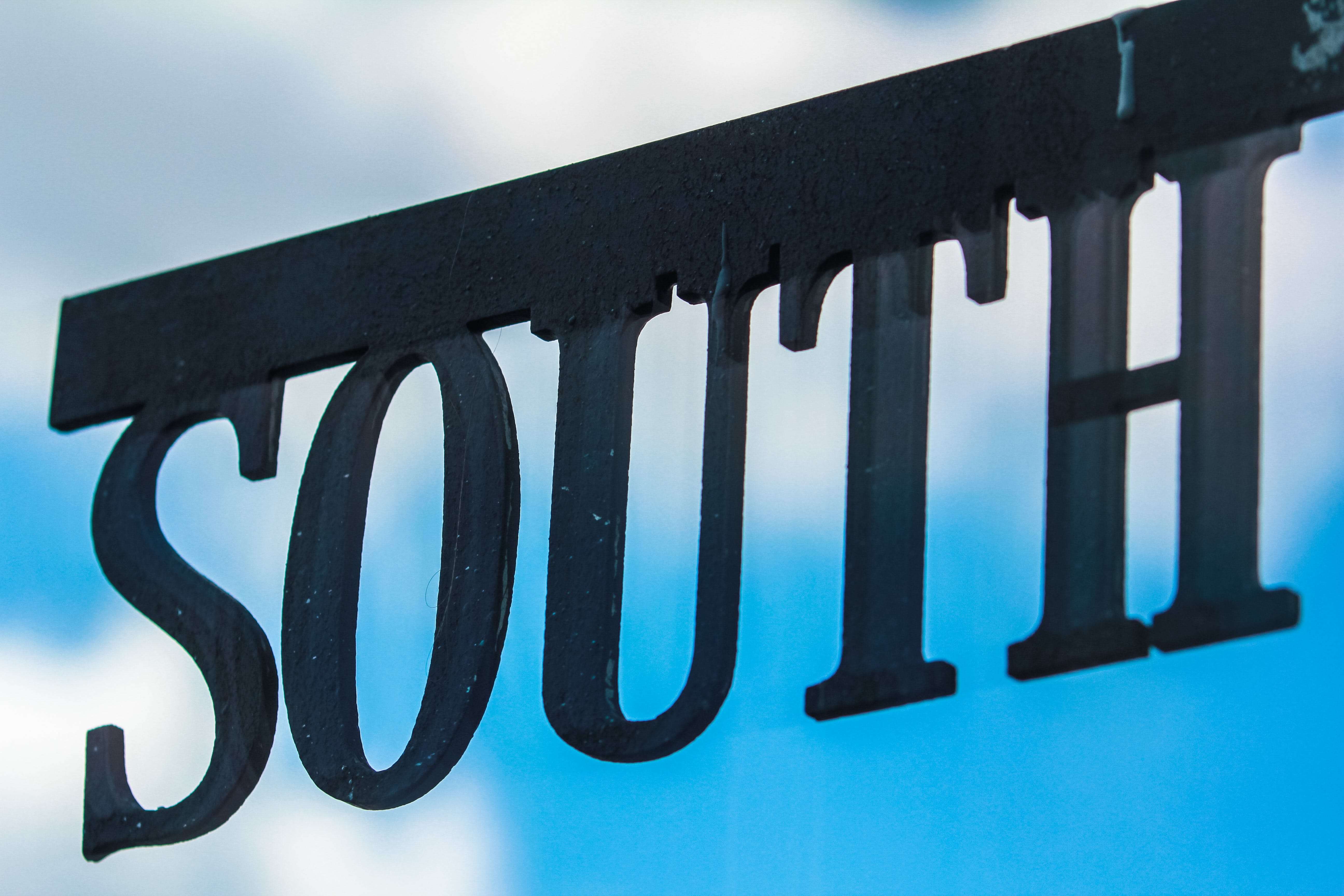 Selective Focus Photography of Black South Signage