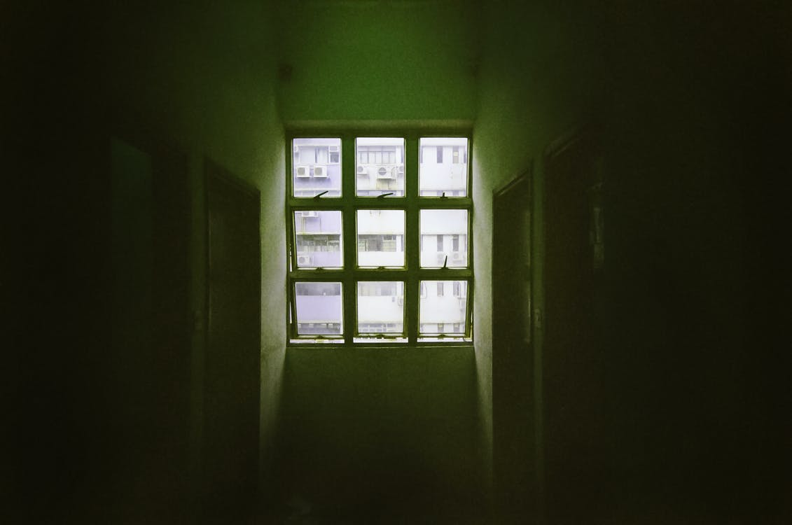 Sun Shine on 6-pane Window in Dark Room