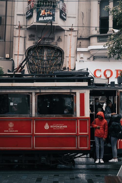 People in Red and White Tram