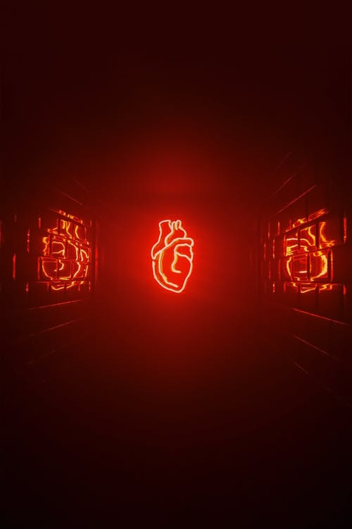 Neon heart shining in red