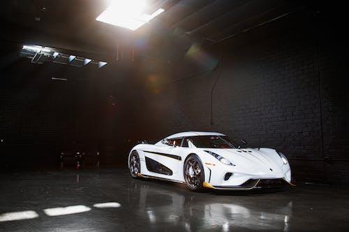 White Porsche 911 Parked in a Garage