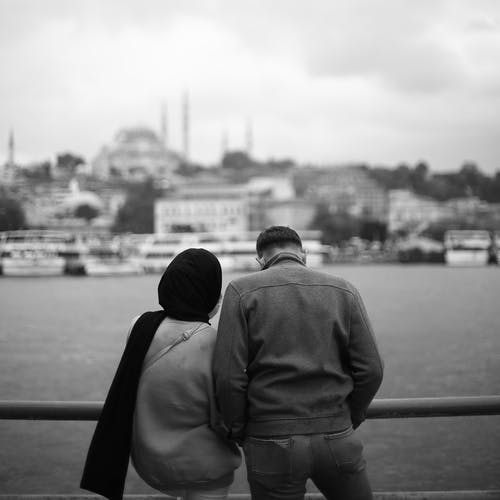 Man and Woman Standing Together Beside the River