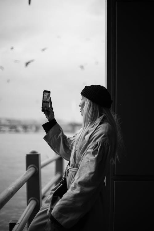 Blonde woman making photography