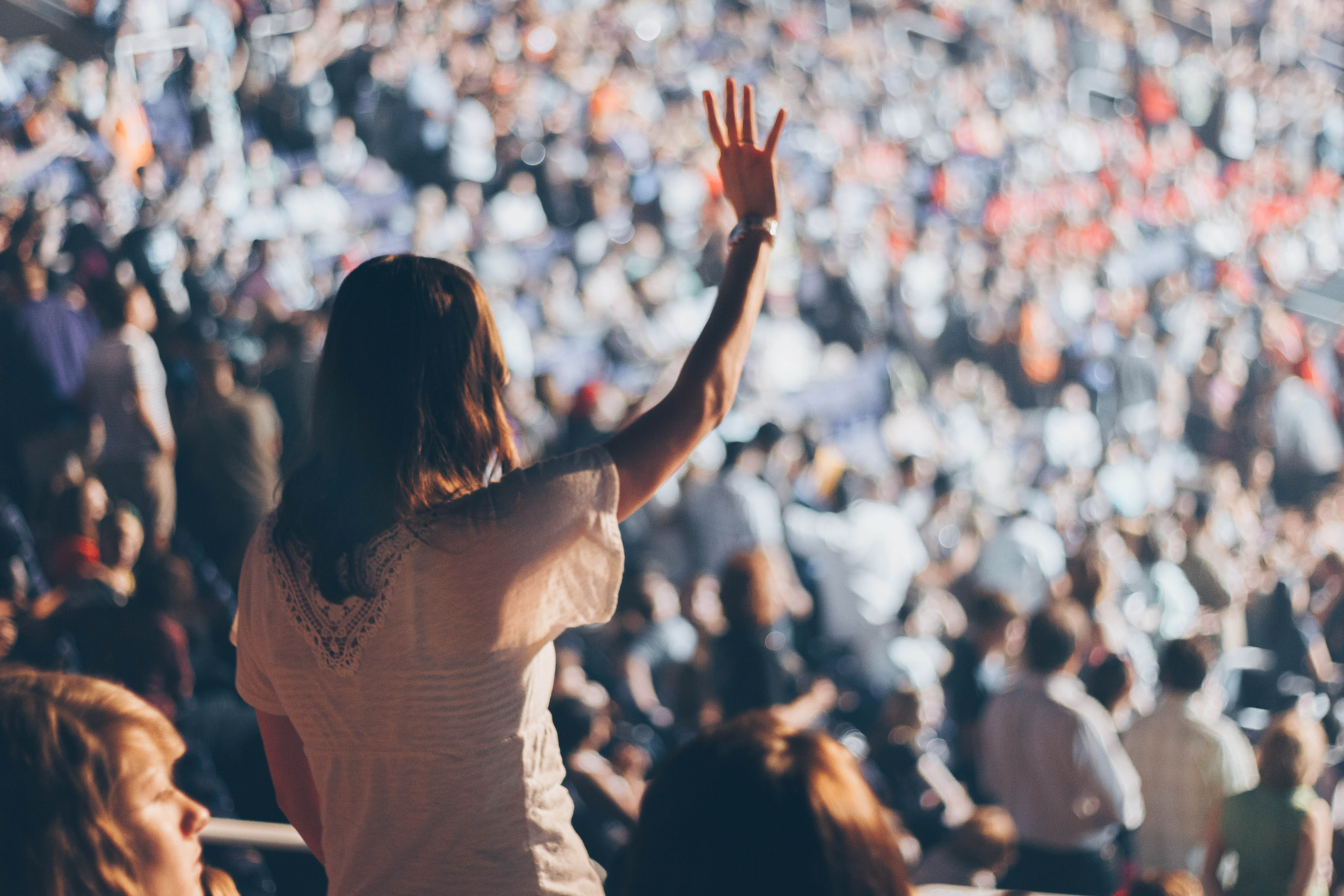 Woman With White Shirt Raising Her Right Hand