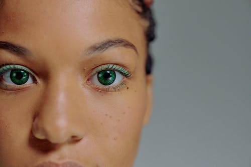 Close-up of face of woman with green eyes