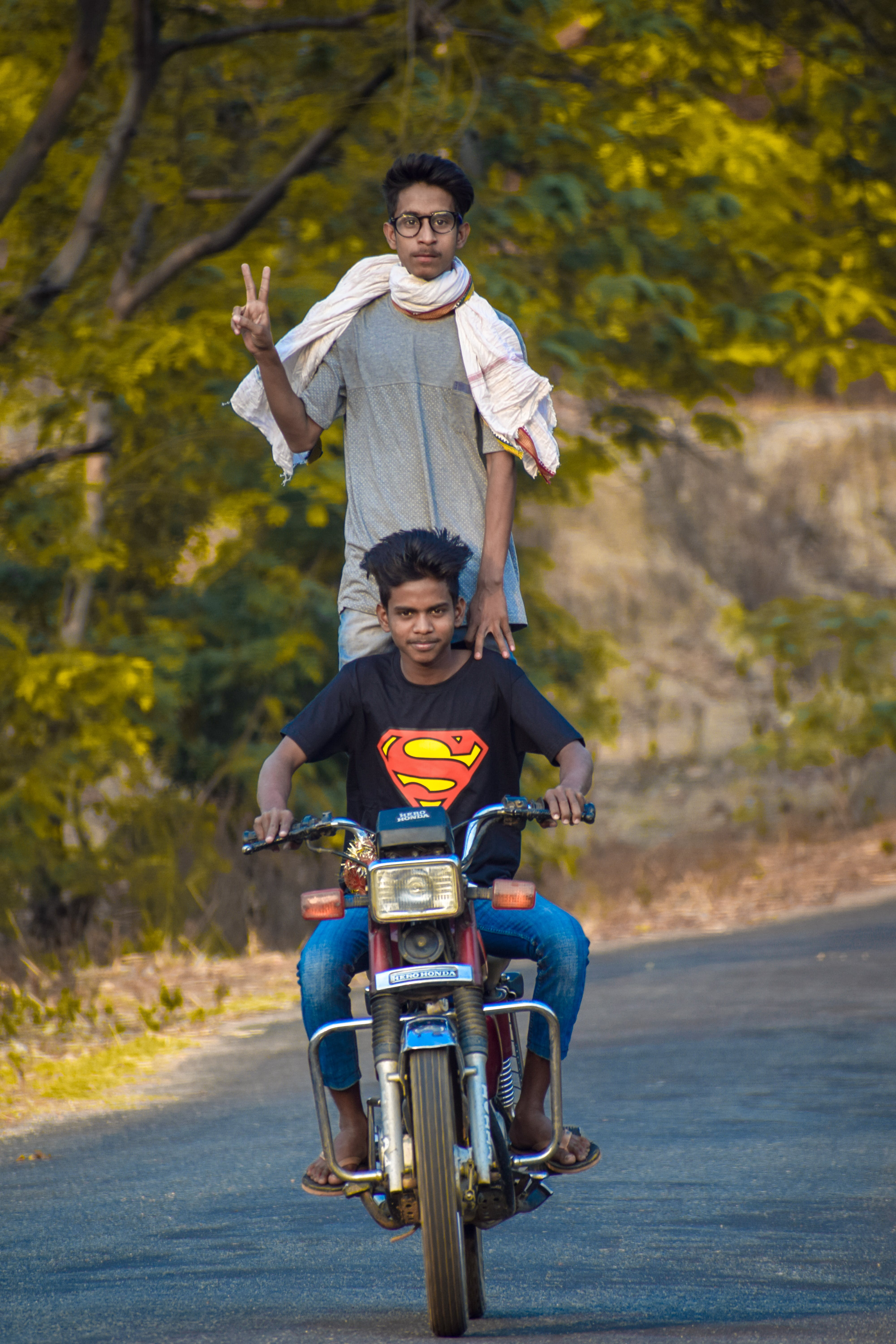 Two Men Riding a Standard Motorcycle