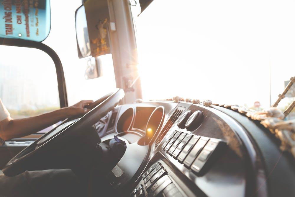 Driver's hand on steering wheel.   Photo: Pexels