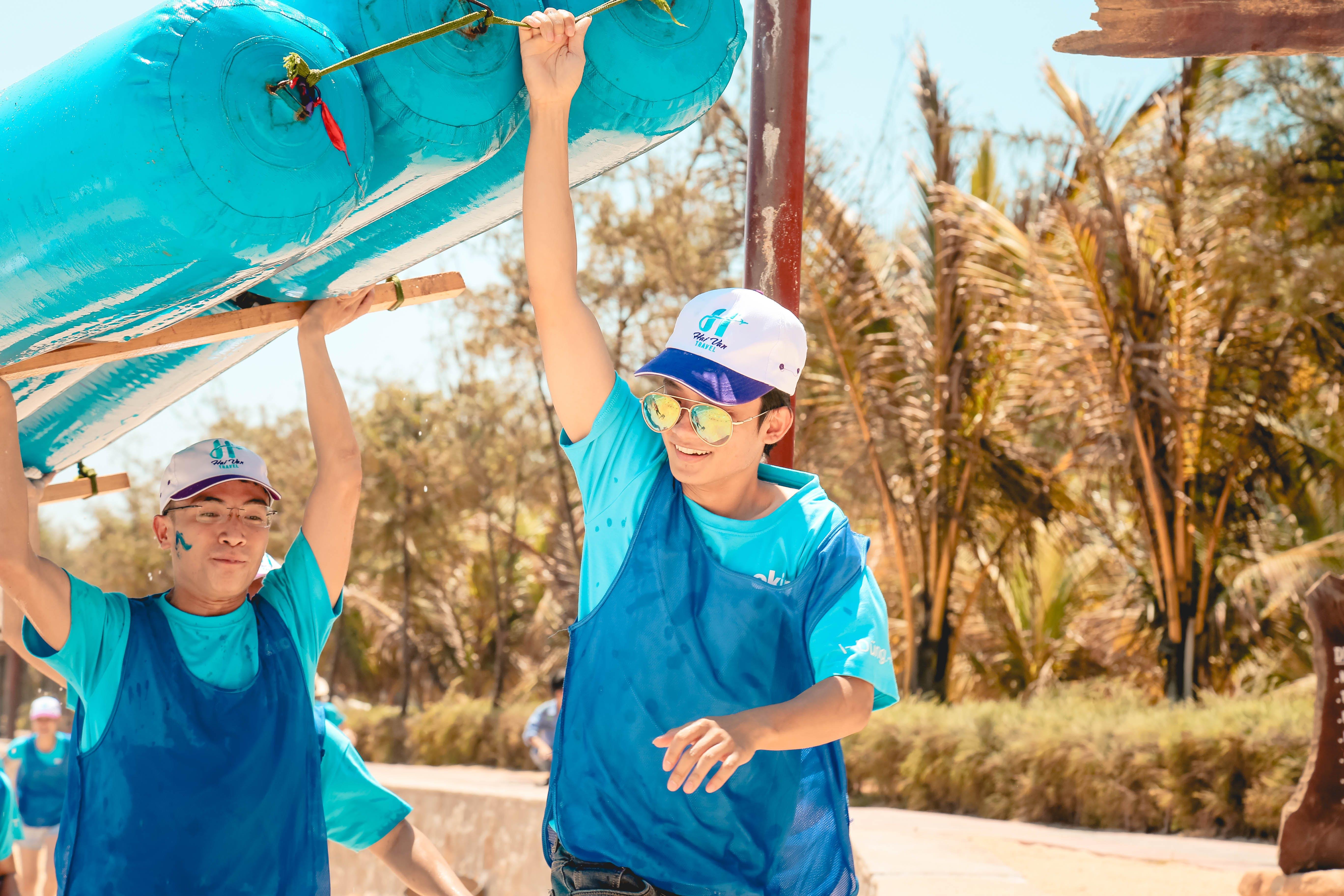 Men in Blue Holding Blue Boat