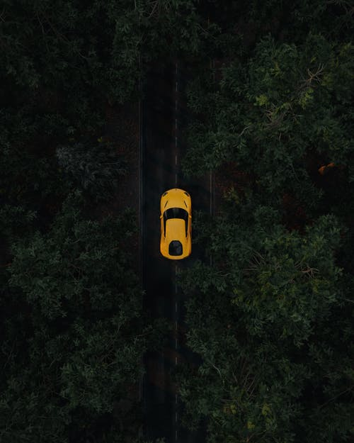 Yellow Sportscar Driving on Middle of the Road