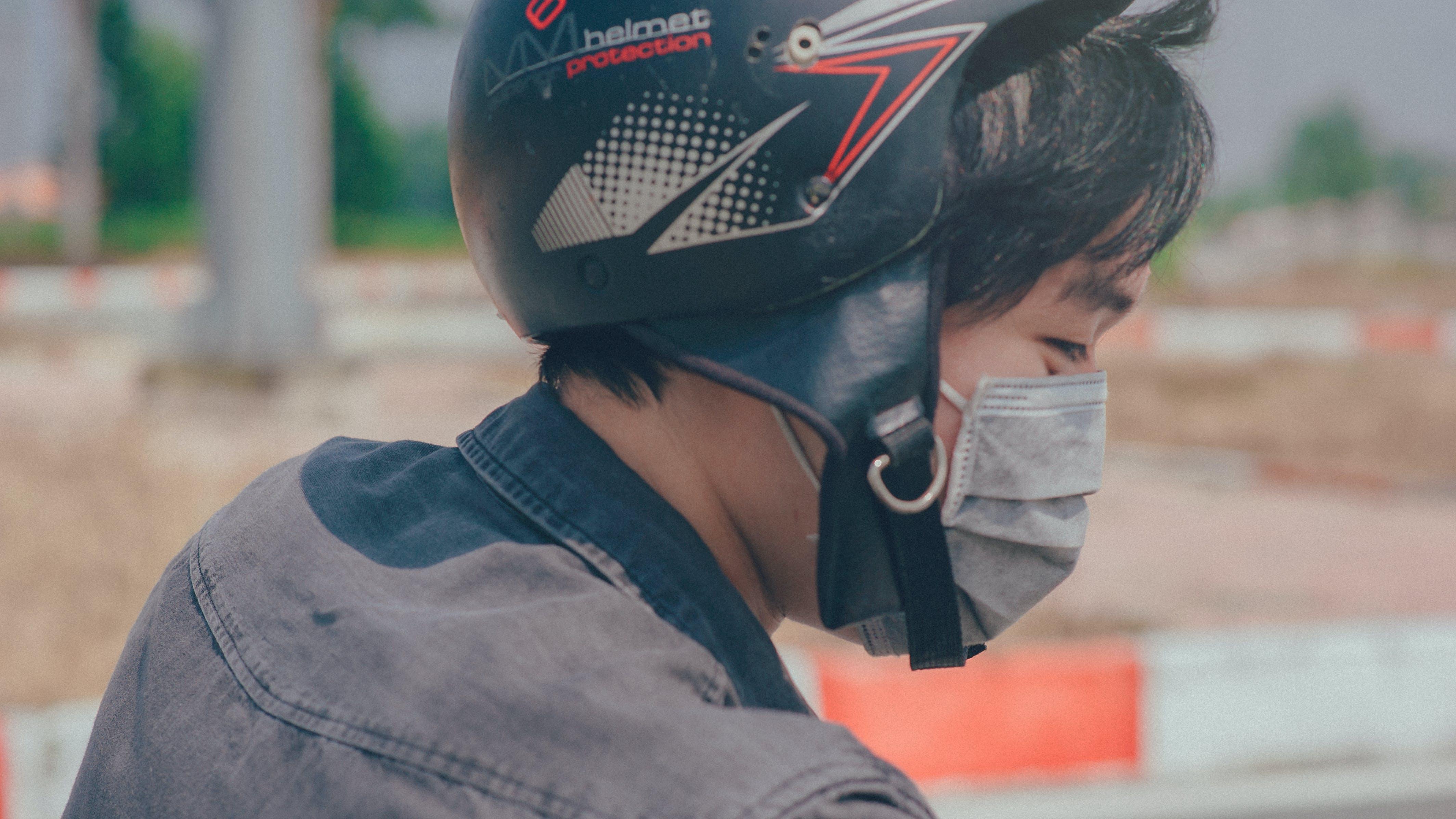 Безкоштовне стокове фото на тему «азіатський чоловік, Вулиця, гоночний трек, денний час»