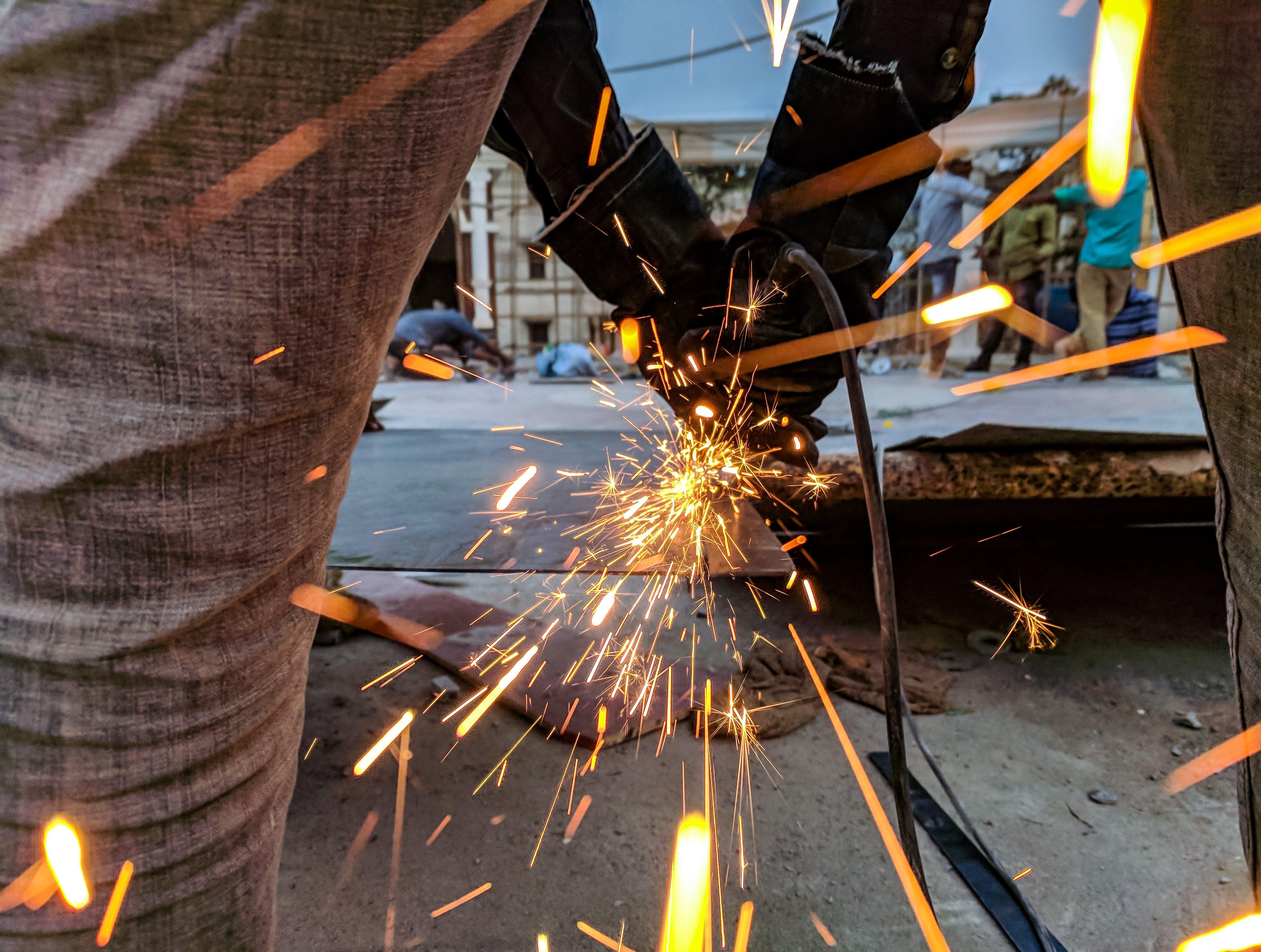 Man Cutting Steel Using A Power Tool