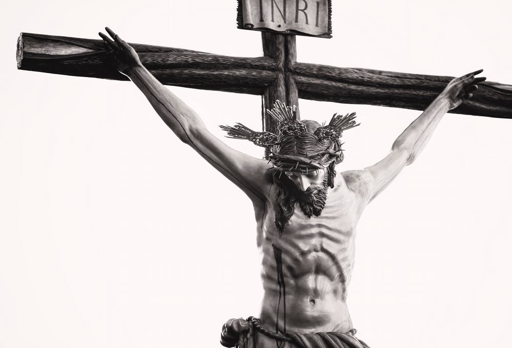 Grayscale photo of the crucifix. | Photo: Pexels