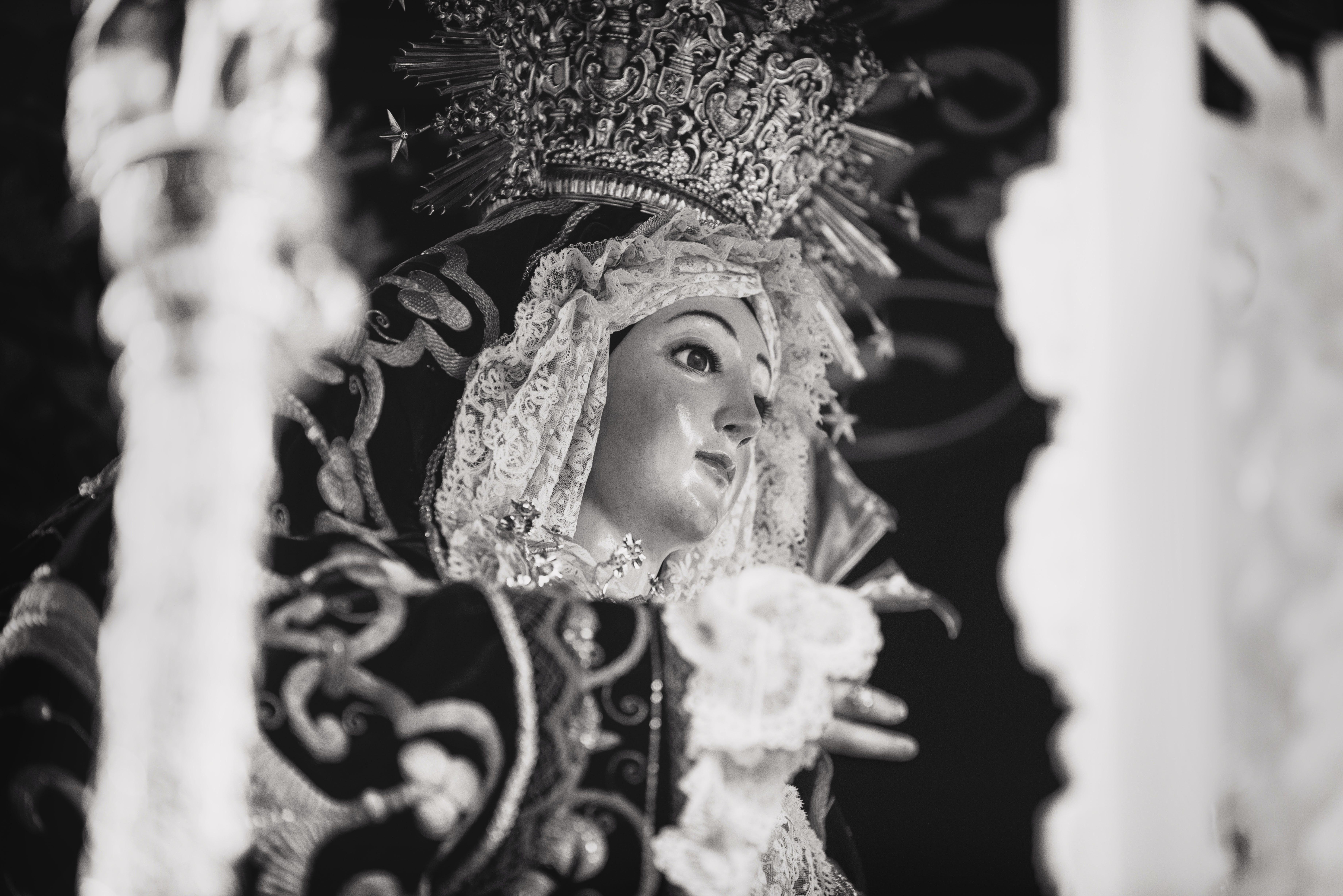 Grayscale Photo of Religious Figurine