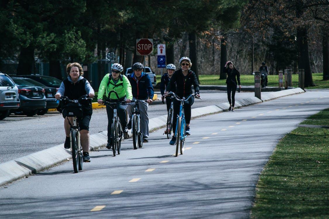 Five Person Riding Bikes