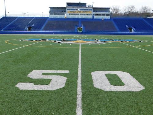 Free stock photo of 50 yard line, American football, athletic field, football stadium