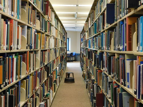 Free stock photo of books, library, shelves