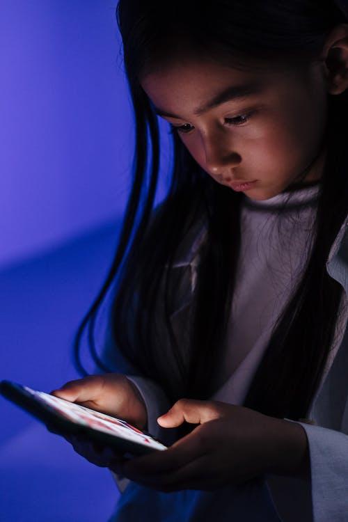 Young girl using smart phone