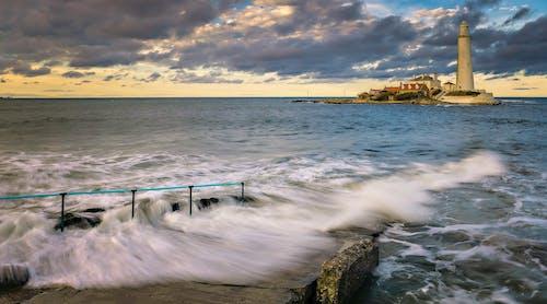 Kostnadsfri bild av fyr, gryning, hav