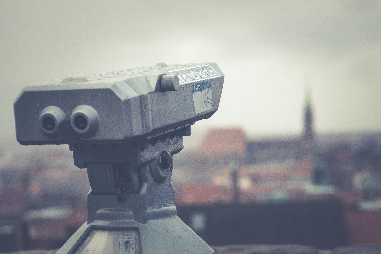 Gray Telescope Above Building