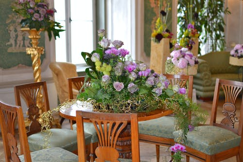Purple Petaled Flowers on Brown Table