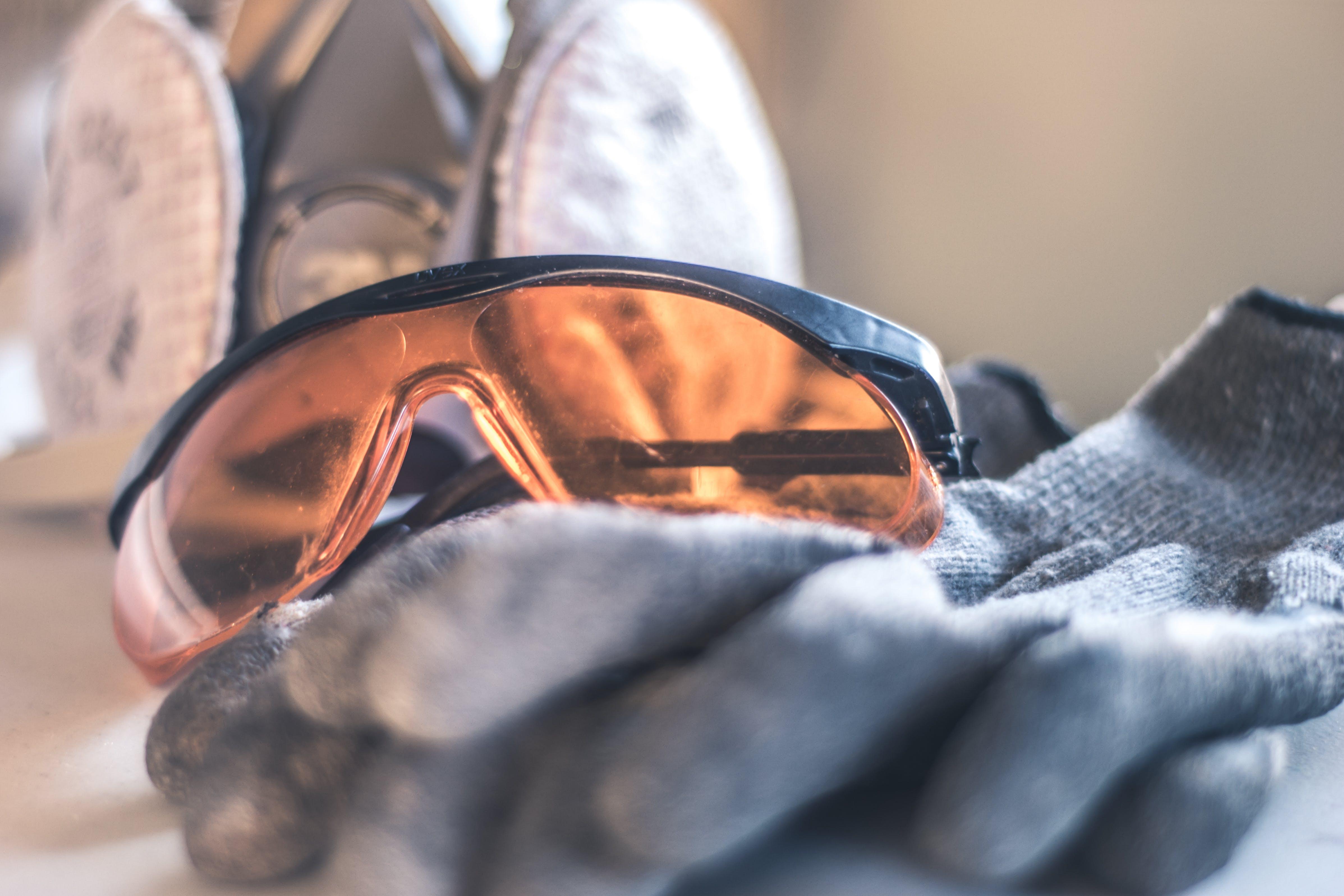 Closeup Photo of Black Framed Brown Sunglasses