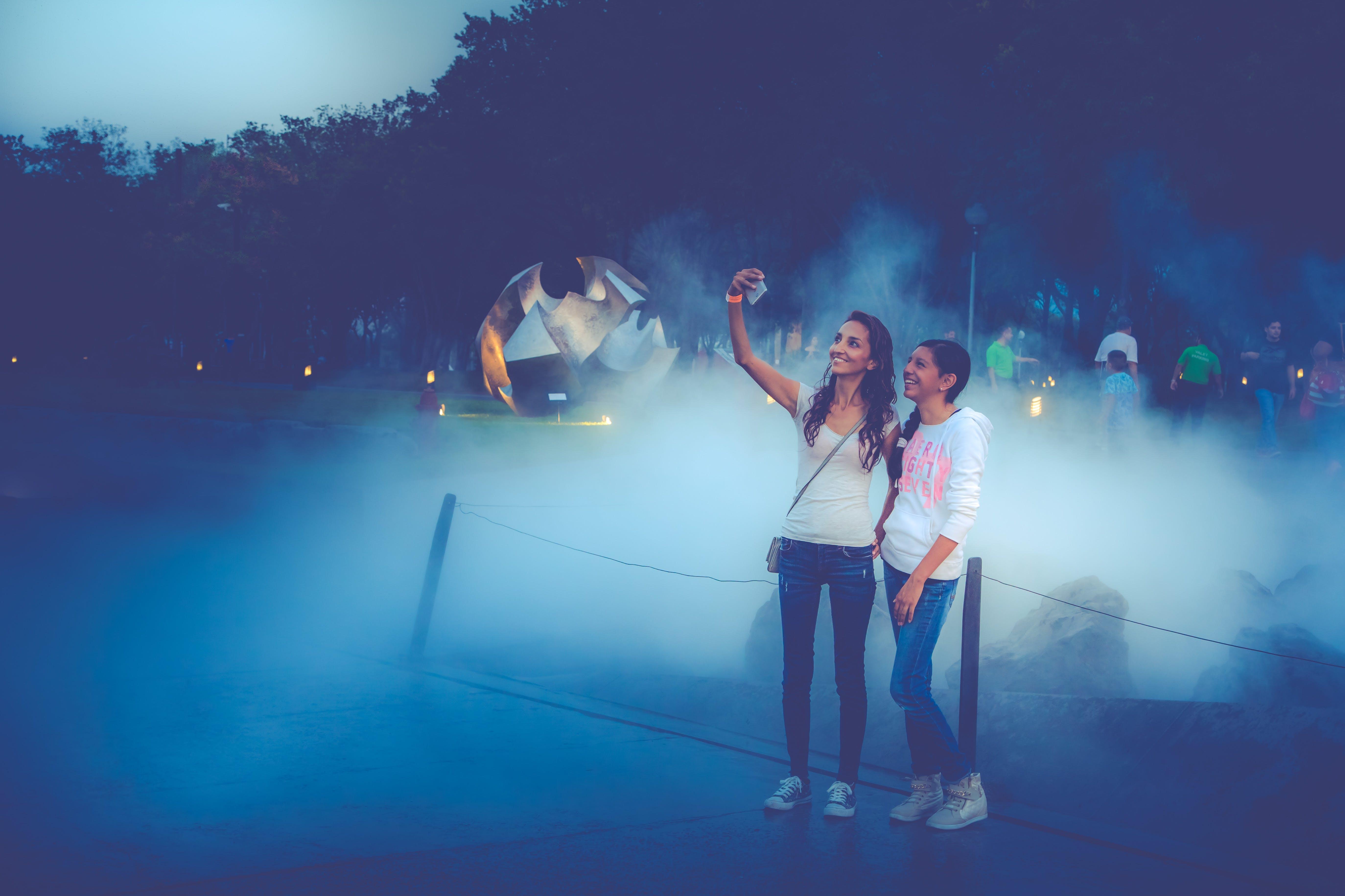Photo Of Two Women Taking Selfie
