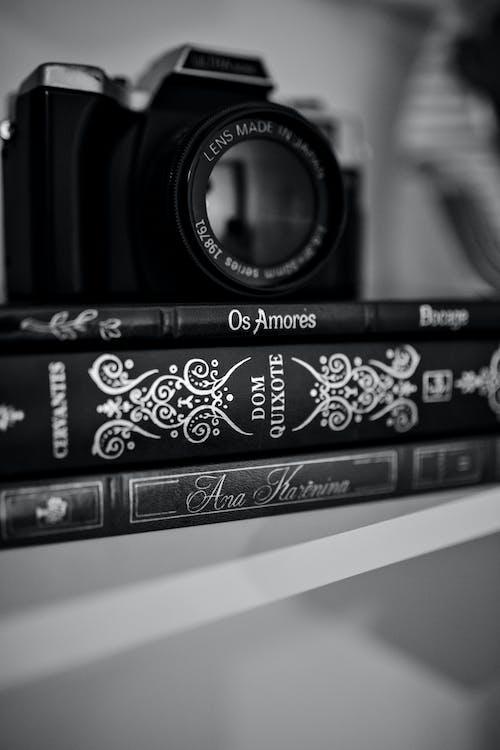 Free stock photo of b amp w, books, camera