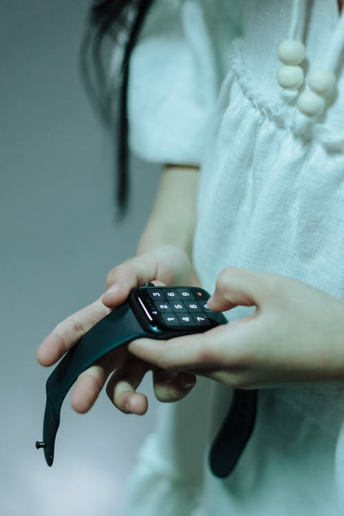 Close-up of girl using smartwatch