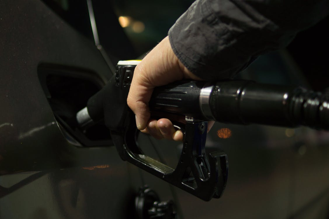 Person Holding Gasoline Nozzle