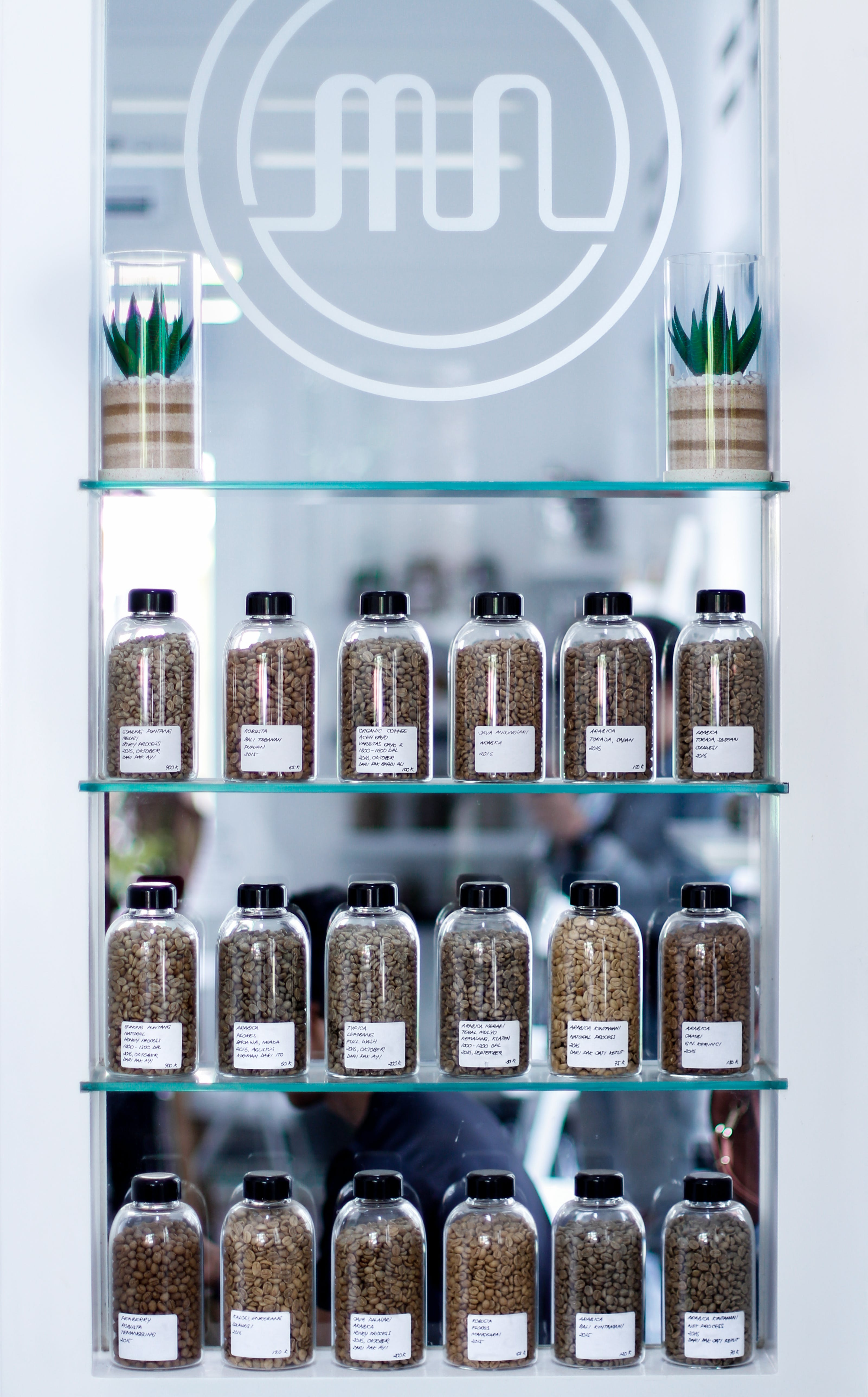 Clear Glass Containers On Glass Shelves