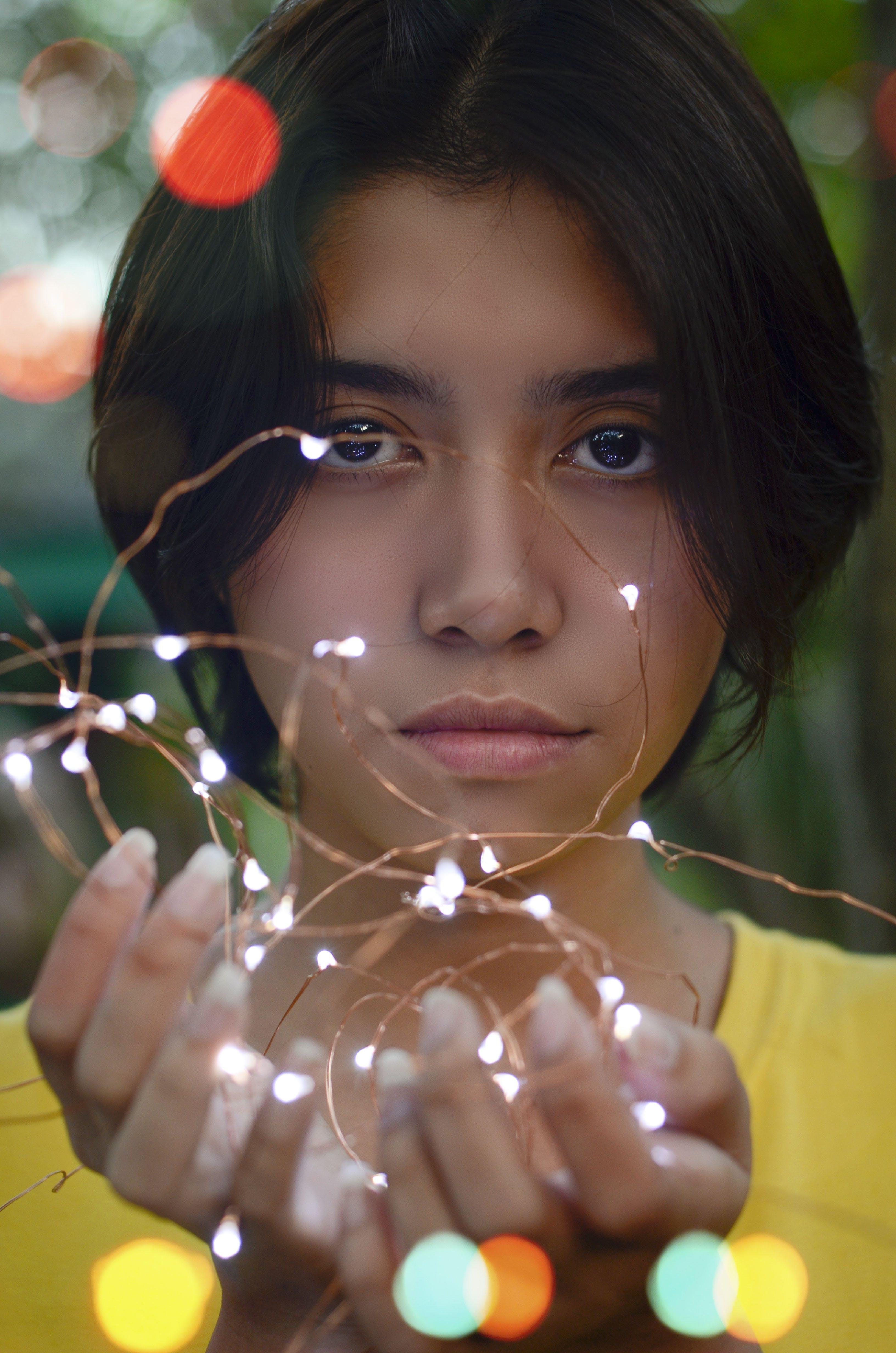 Girl Holding String Lights