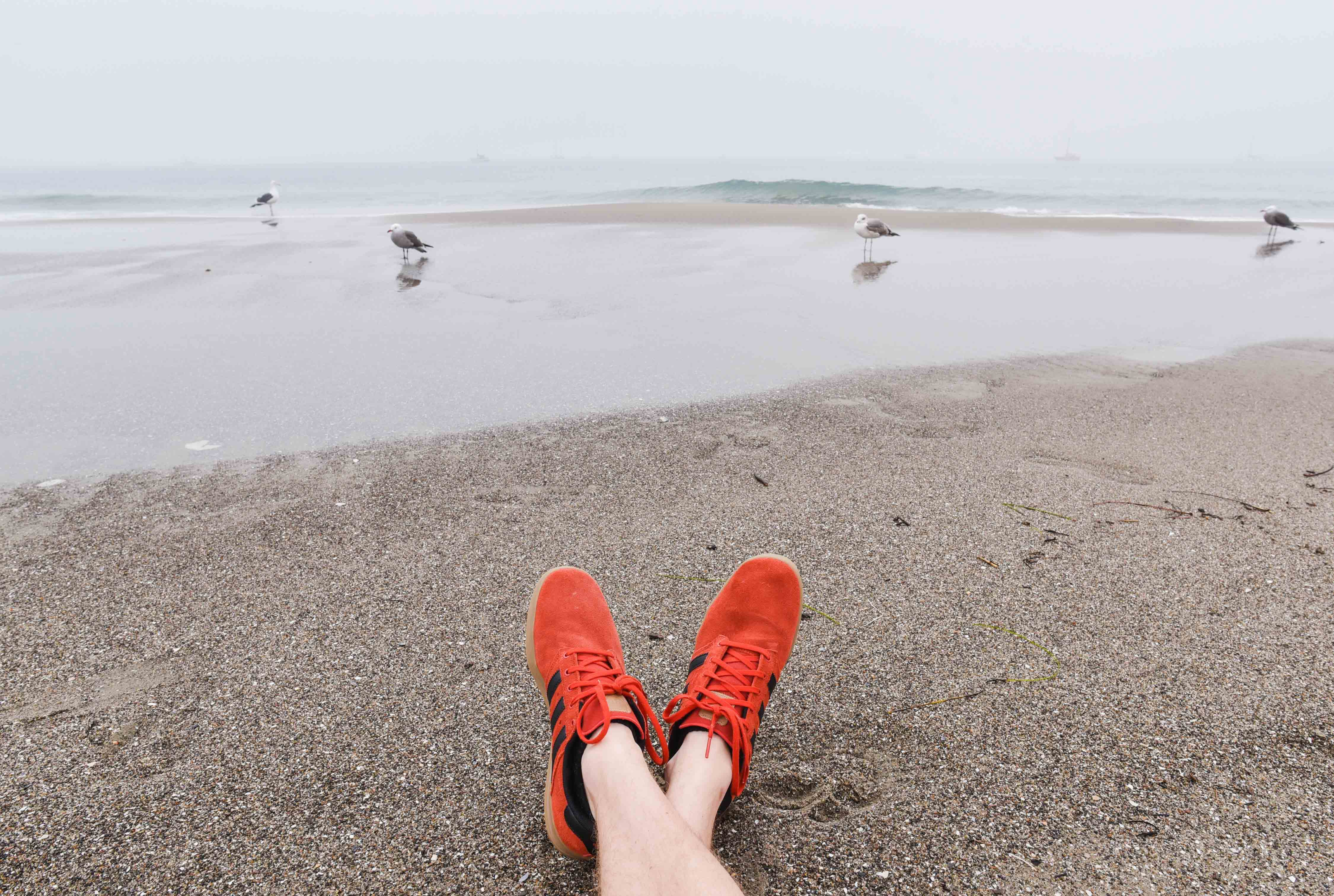 Person Wearing Orange Adidas Running Shoes