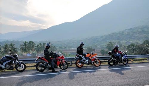 Kostnadsfri bild av asfalten, cyklist, förare, fordon