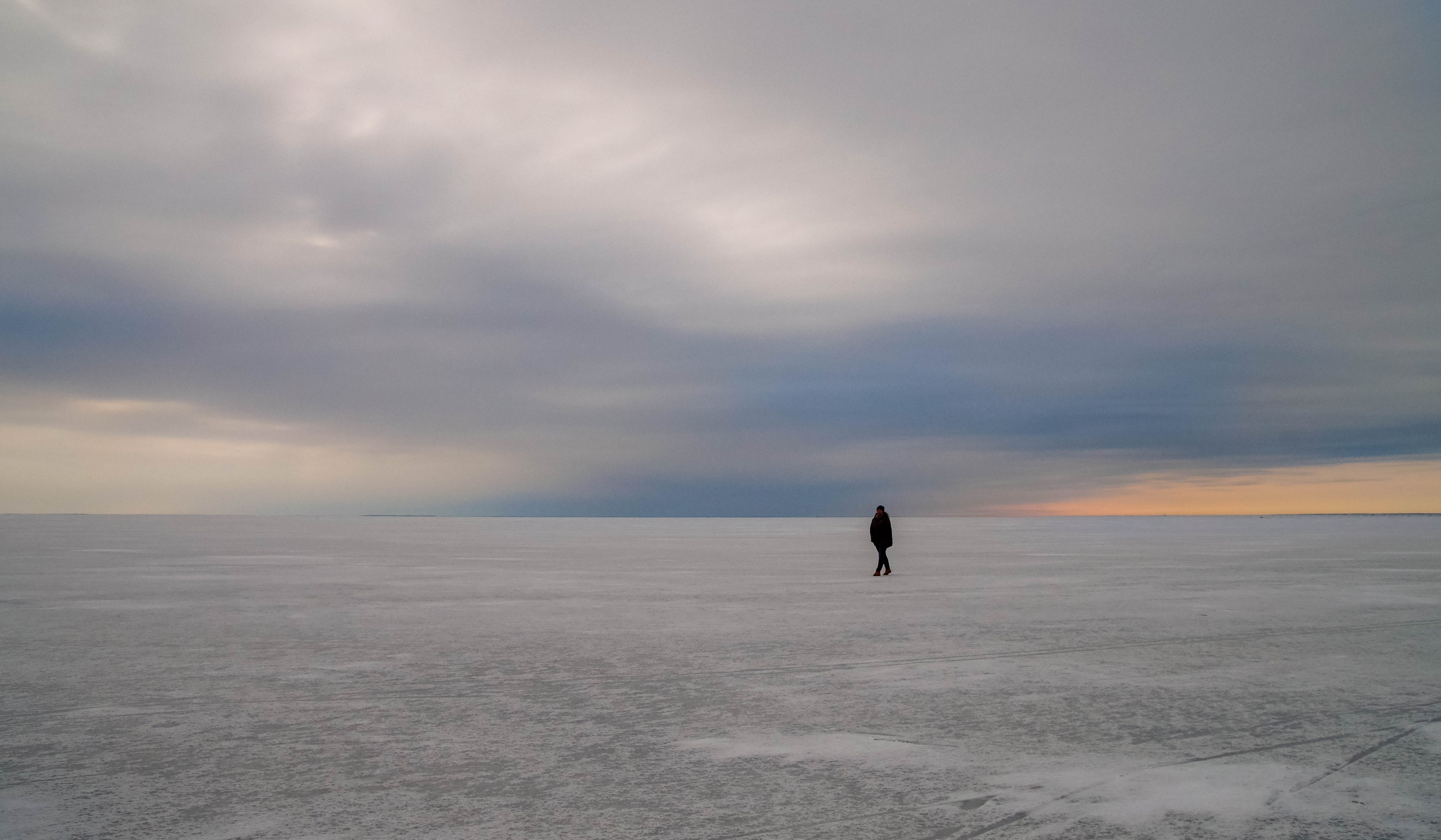 Silhouette of Person Walking on Vast Land