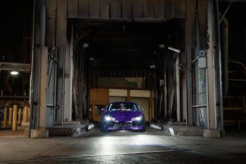 Blue Car in a Garage