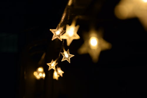 Shallow Focus Photography Di Yellow Star Lanterns